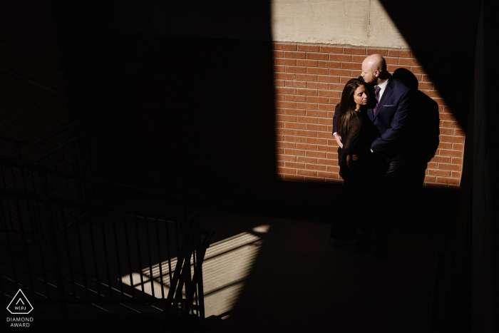 The Pearl Brewery Engagement Photo Session   Couple in the light with angled shadows in a parking lot
