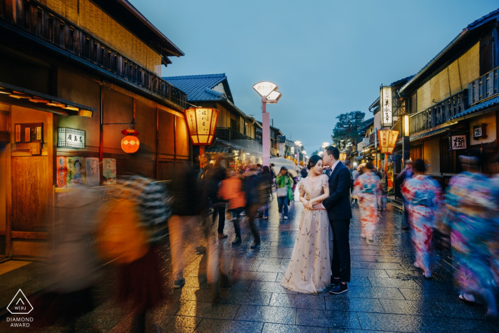 Kyoto, Japan Couple on the evening street. Engagement Photography at Dusk.