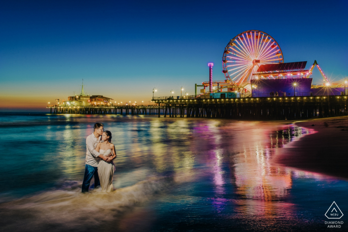 Santa Monica, Los Angeles Engagement Photography   Couple by the sea in the evening.
