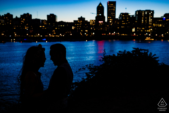 A silhouette of a couple with background of Portland Oregon | engagement photography
