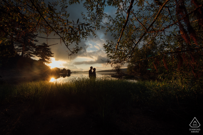 Calabria, Italy intimate engagement shoot at sunset with a couple by the water.