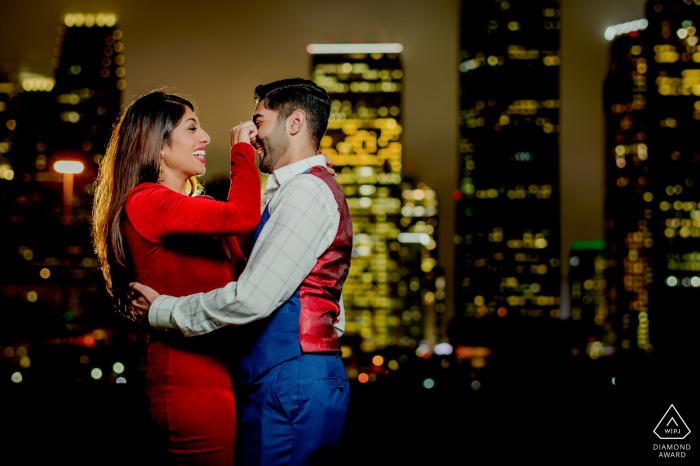 Houston, TX Couple madly in love with the background of skyline