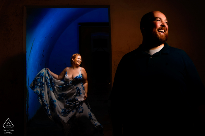 El Morro, San Juan PR wedding and engagement photographer: 3 light setup, 1 with blue gel behind the Lady and light 45 degree right for lady. One light for the guy on right at 45 degrees.