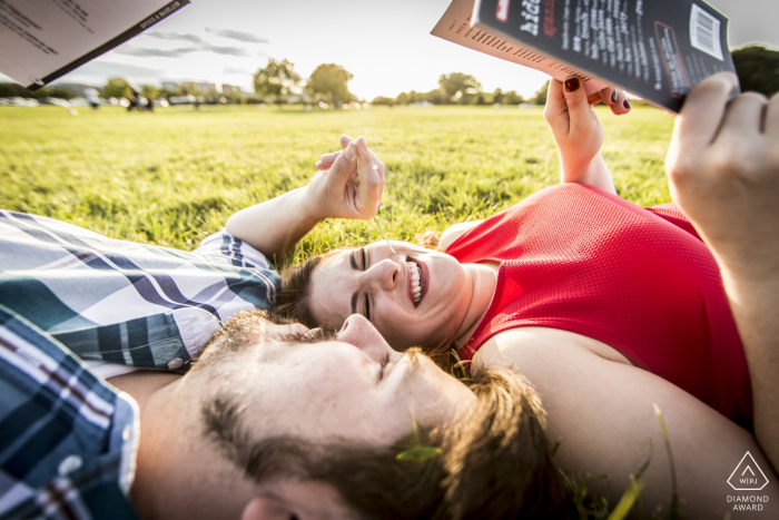 Gravelly Point Park, Arlington, VA engagement photographer: The couple brushing up on their French and Spanish for their honeymoon