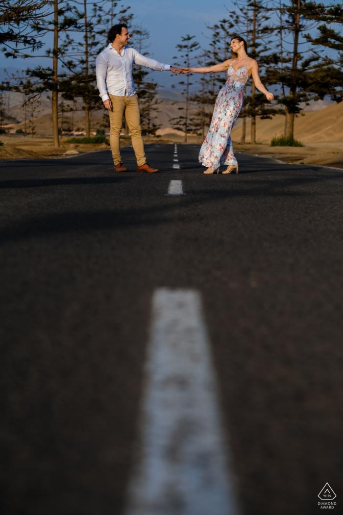 75/5000 Santa Maria - Lima - Peru Road | Portraits of an enaged couple playing along the access road to Santa Maria beach