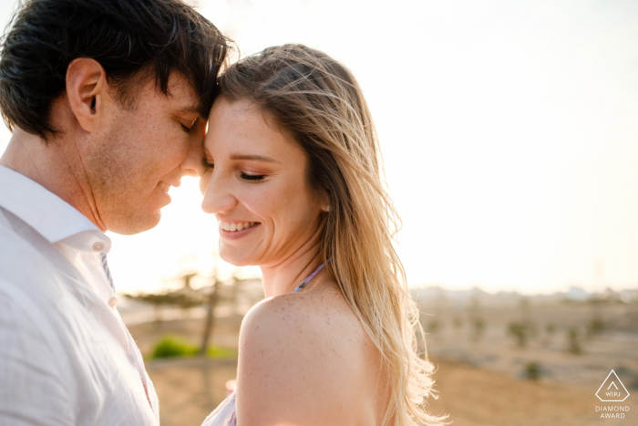 Santa Maria - Lima - Peru couple touches faces in the afternoon sun for an intimate engagement portrait.