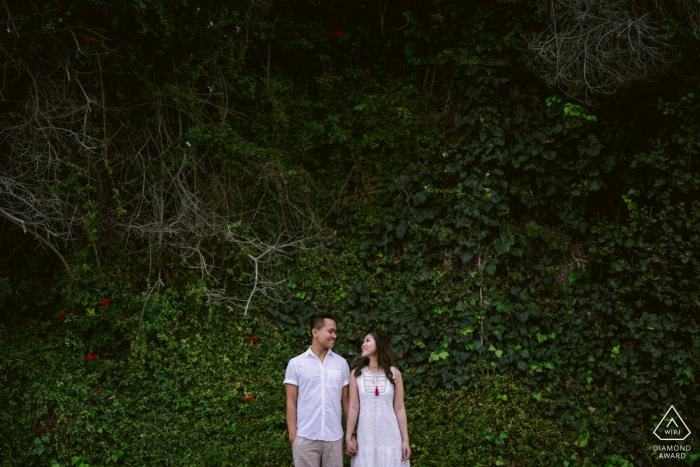 Corona del Mar State Beach, CA engagement session   Happiness is your best friend, love and a tall ivy wall for a green background