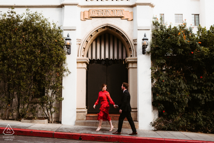 A Hollywood stroll of a couple during a engagement photo session.