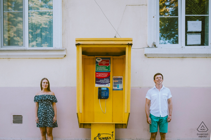 Odessa/Ukraine Prewedding Portraits - a phone box and the couple