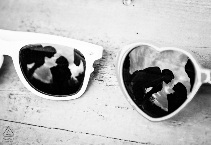 Auch, France engagement photographer of a couple reflected in two pairs of sunglasses