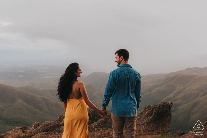 Belo Horizonte, Brazil pre-wedding portrait of a couple looking out to the mountains and valleys.