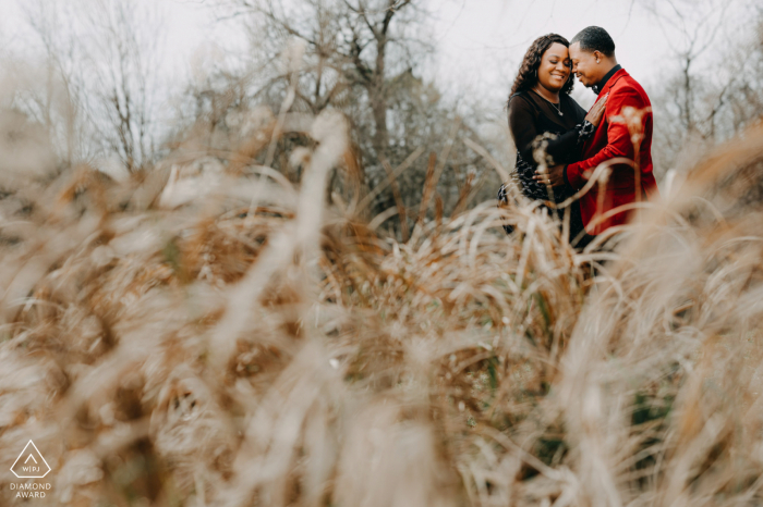 Couple having their happy moment under a sunset and tall grasses at Oyster Creek Park in Sugarland TX