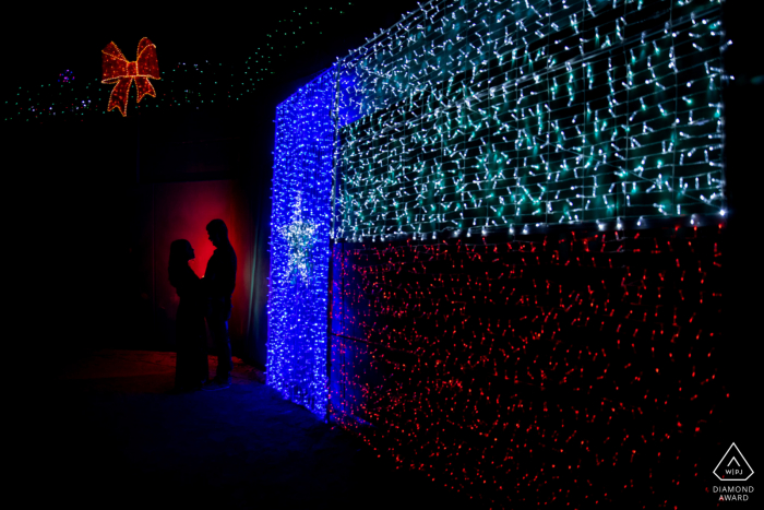 Sugarland, TXCouple's Portrait with red and blue lights indoors.