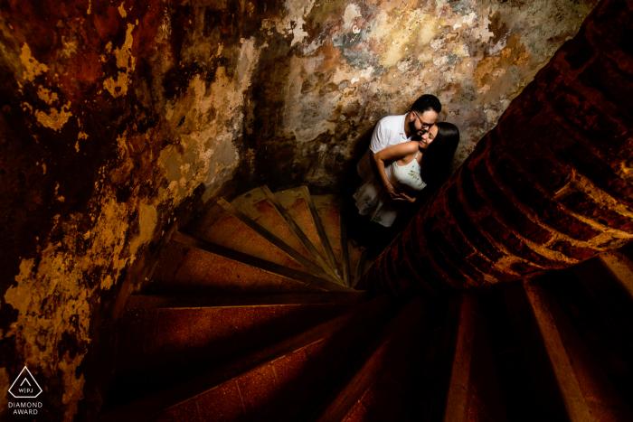 El Morro, San Juan engagement photographer: Using the ladders as a lead line towards couple.