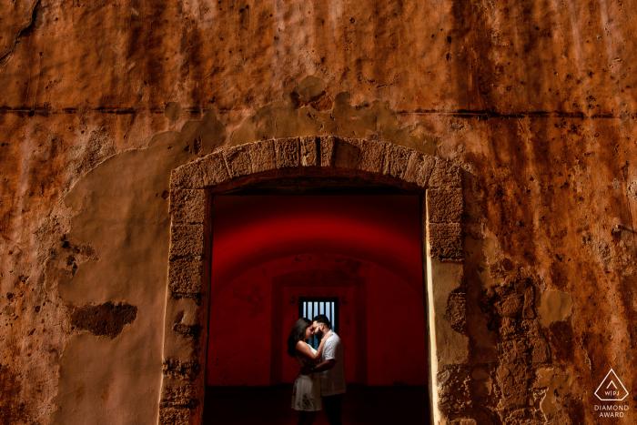 El Morro, San Juan PR Pre Wedding Engagement Photographer: Red gel in the back to pop the framing.