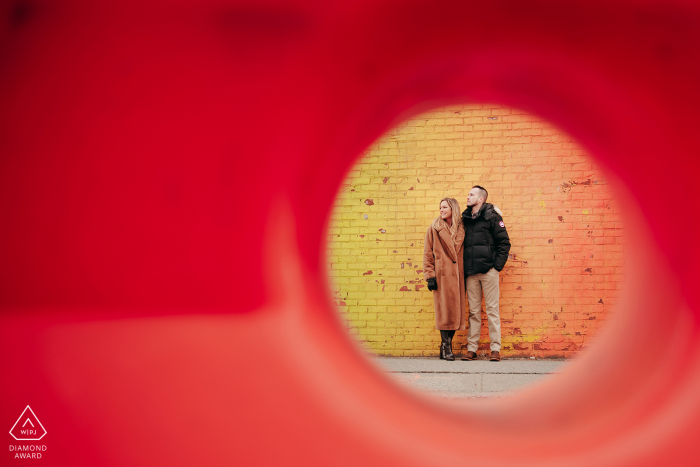 Brooklyn DUMBO engagement photo - The road workers left some road blocks. I used them as a foreground that make almost seamless backdrop for the couple