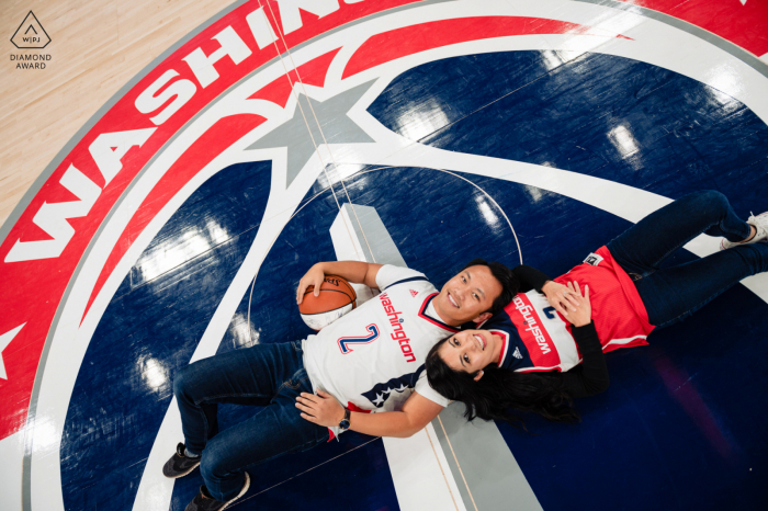 Capital One Arena engagement picture - A rare, on the court photo with two wizards fans