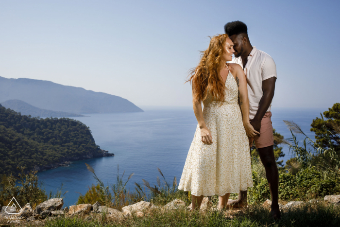 fethiye engagement shooting - portrait image of a couple overlooking the water and bay