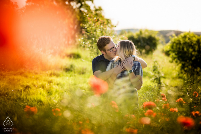 Czech Republic pre-wedding image from Brno - couple sitting in a Poppy field