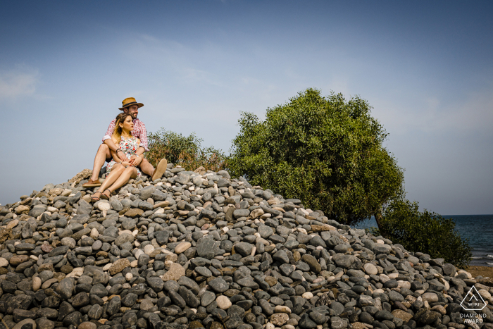 Mersin/Turkey couple on a stone tower during engagement portrait session.