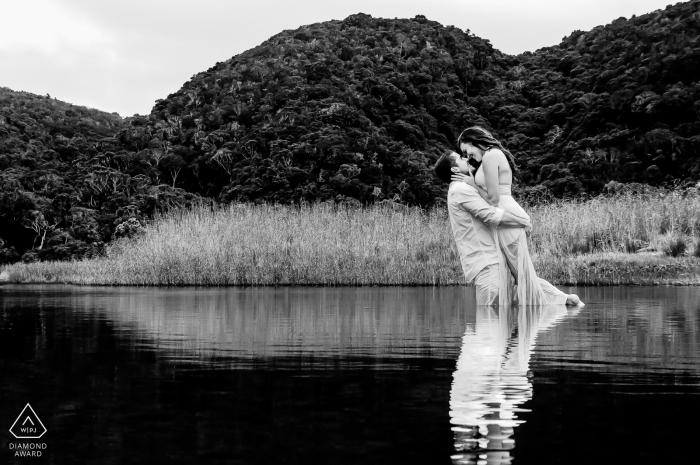 Engaged Couple Session   Knoetzie beach, Knysna - Towards the end of the photo shoot, the couple didn't mind getting wet and we had some fun recreating this Grease movie moment.