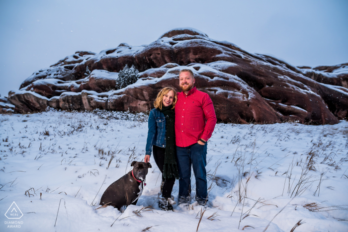 Engagement Photo Session at Ken Caryl, CO - Two engaged cuties and their dog pose during a snowstorm