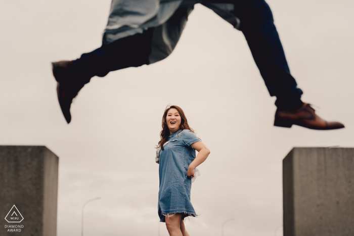 Engagement Photographer | Iceland Man jumping over lady