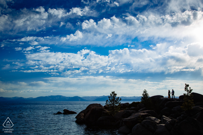 Engagement Photos | Lake Tahoe, CA Engagement photo of man and woman standing on rocks
