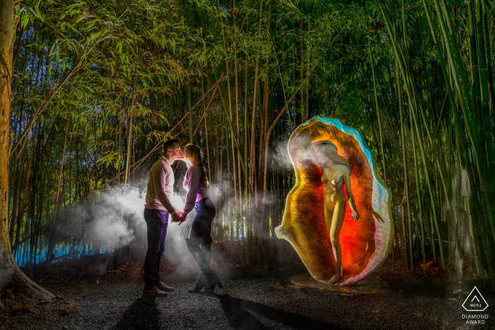 Engaged Couple Session | Grounds For Sculpture in New Jersey - A couple steals a kiss as a statue of Venus looks on.