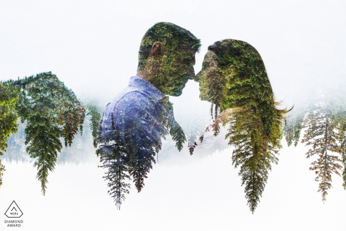 Engagement Photography | Rocky Mountain National Park, Estes Park, Colorado, USA - A unique portrait of a couple combined with the evergreen treetops.