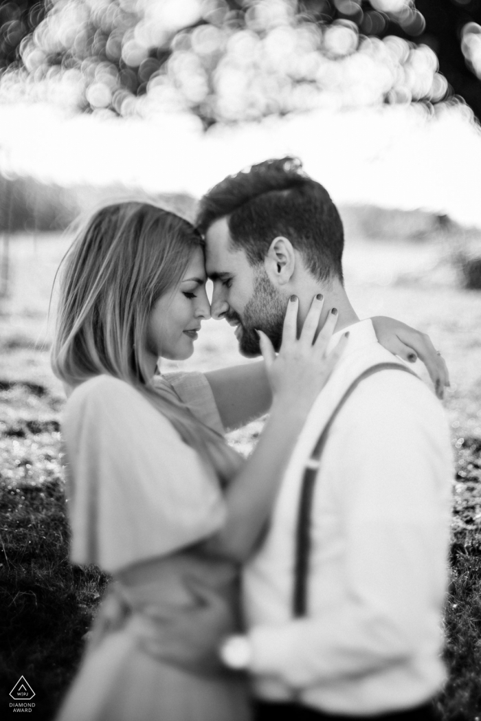 Engagement Photographer | In a field in Belgium - the couple who will marry this year. Shot with a vintage tilt lens.