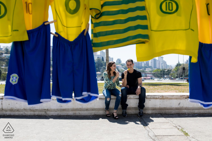 Engagement Photo Session at São Paulo - A sports couple eating ice cream in front of the football museum