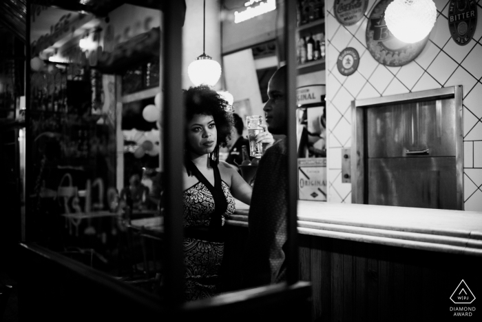 Engaged Couples Photographer | BECO Bar - Brasília - Brazil Couple having good time at the bar