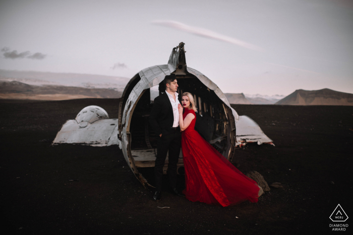 Iceland Engagement Photography | Red Dress and Plane Crash