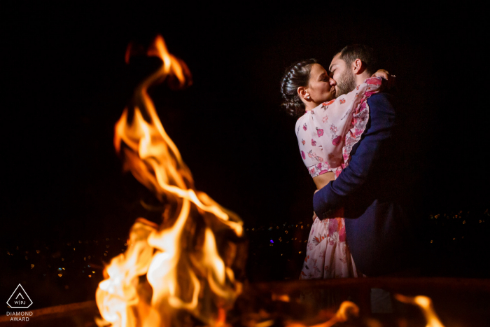 fethiye, turkey engagement portrait session next to an open fire at night
