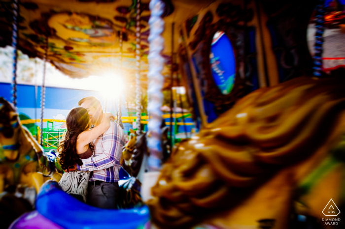 "Western Cape wedding photographer: ""This was taken at Gold Reef City theme park in Johannesburg, South Africa. The park was almost closed and we sneaked in a last photo with an empty merry-go-round and the late afternoon sun."""