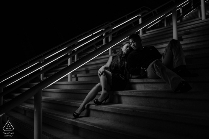 Engagement photography of a couple of stairs at night in San Diego, CA