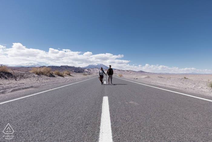 Open road and painted lines lead you right to the engaged couple in the atacama desert