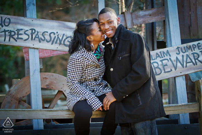 A laughing couple has some fun during their engagement portrait shoot in Stone Mountain, GA.