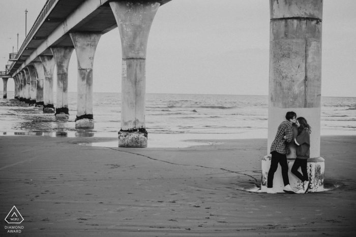 New Brighton Beach, Christchurch, New Zealand Cold afternoon engagement portrait with body language mirroring.