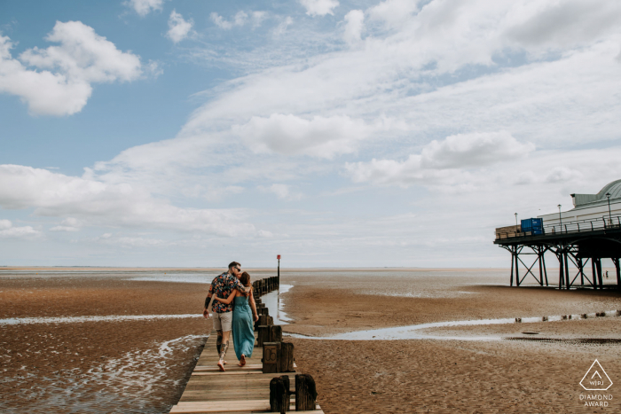 Lincolnshire, UK engagement portrait | Zara and Alex walk along the beach in Cleethorpes at the beginning of their pre-wedding shoot.