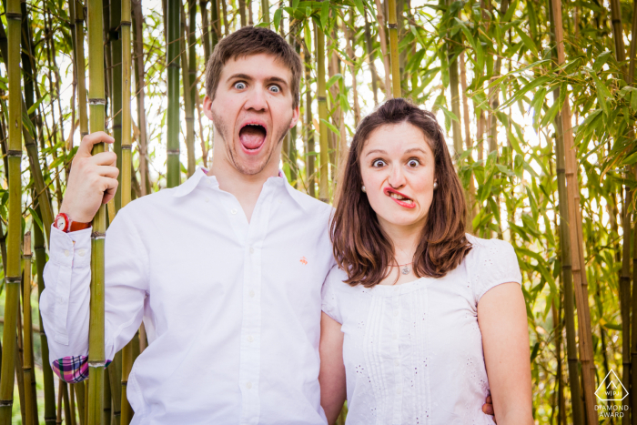 A couple is making a funny face during portrait session in Japanese garden at Toulouse