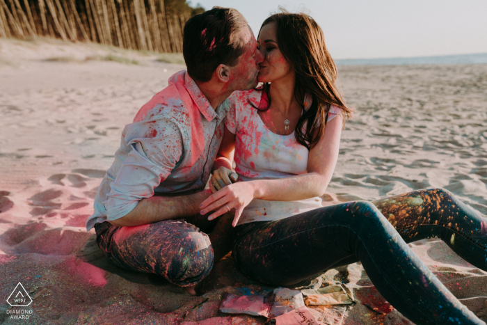 A kiss on the beach after playing with holi powder at Mielno