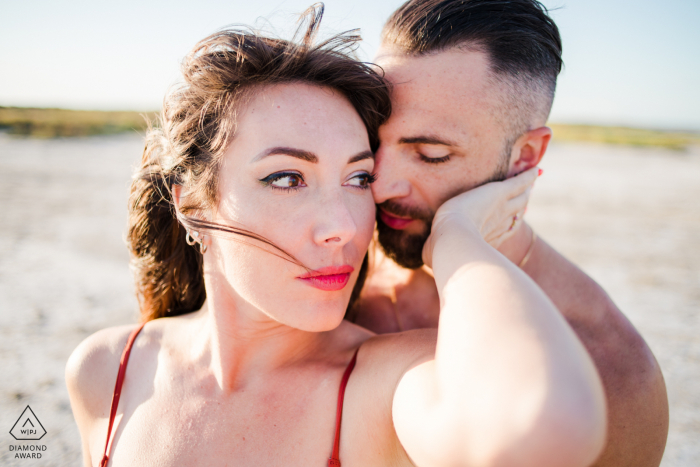 an engaged couple embrace on the Camargue France beach for a portrait