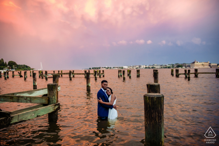 Annapolis Maryland engagement portrait session in the water with a Double Rainbow sunset