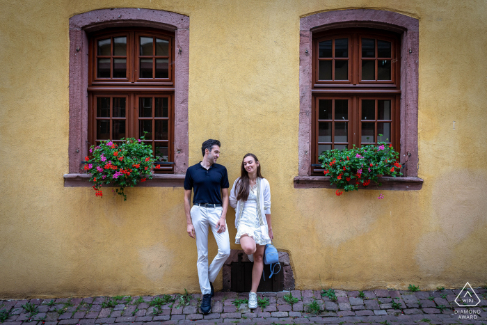Riquewihr - Alsace couple portraits in the village streets with windows and planters