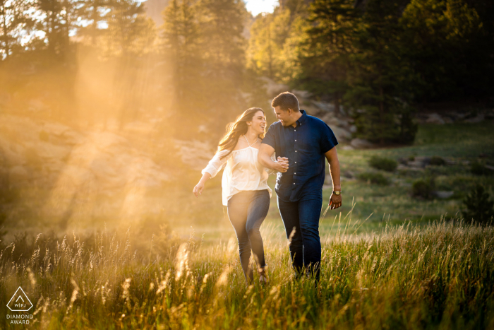 a young couple walk together during their engagement photoshoot in Lake George, Colorado