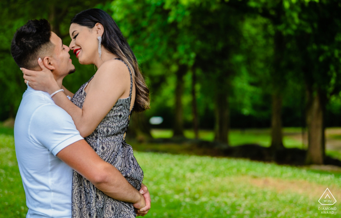 Holding his fiance close to him in a very romantic engagement portrait at Founder's Park, Farragut, TN