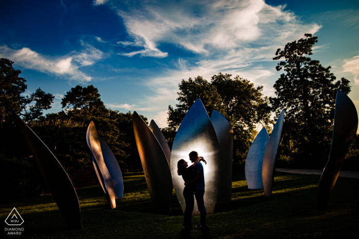 jackson park, chicago engagement portraits with a couple in front of a sculpture