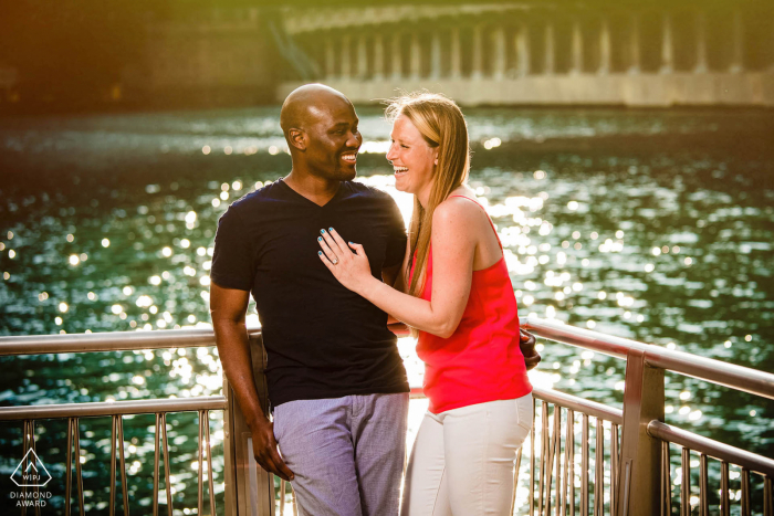 Chicago couple stand on a dock near the waterside for their engagement portrait